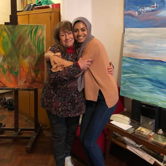 Student Abroad Embracing New Friend in Art Studio