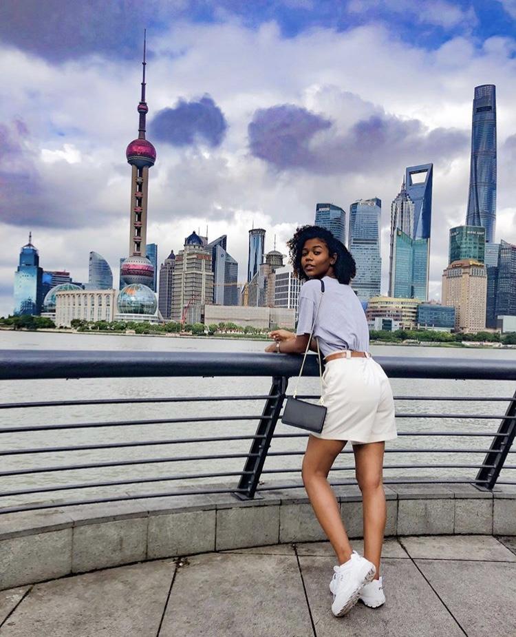 Student and Shanghai skyline