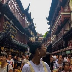Woman standing in busy chinese town